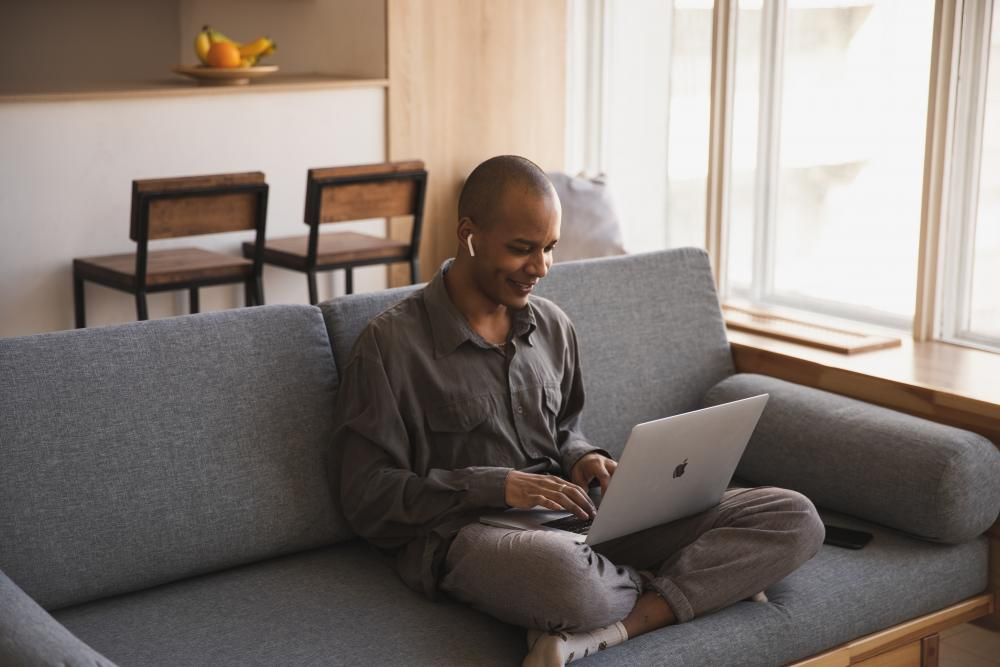 Man working at home using a laptop