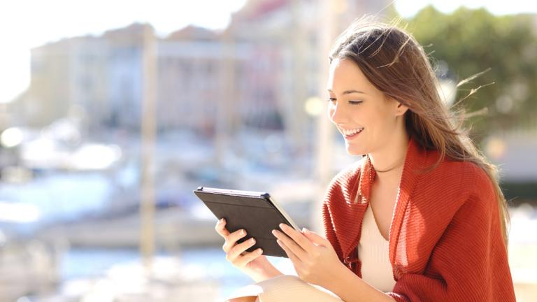 Woman using a tablet watching media content