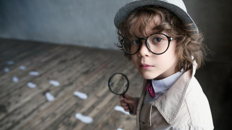 Boy playing detective