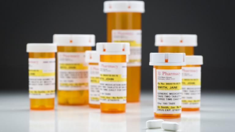 Pill bottles on reflective surface