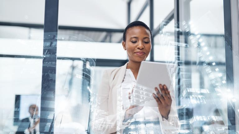 Multiple exposure shot of a mature businesswoman using a digital tablet in a boardroom superimposed on a cityscape