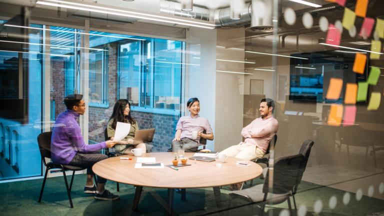 Start-up businesses are developed in coworking spaces in London, United Kingdom. Multi-ethnic teams with young experts from all around the world are involved in project development.