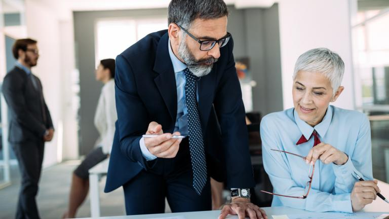 mature business man and woman having manager meeting