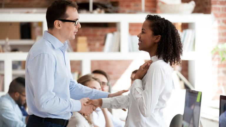 team leader giving praise to an employee