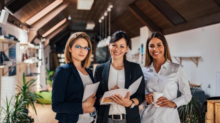 Group portrait of confident female business team.
