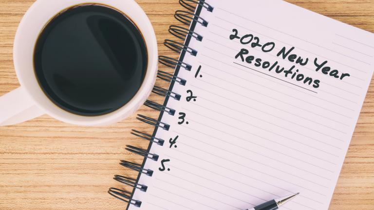 2020 New Year's Resolutions text on notepad
