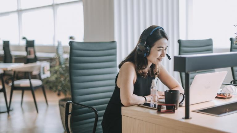woman at her desk on video call