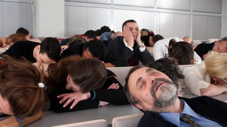 Sleeping audience at a boring business seminar