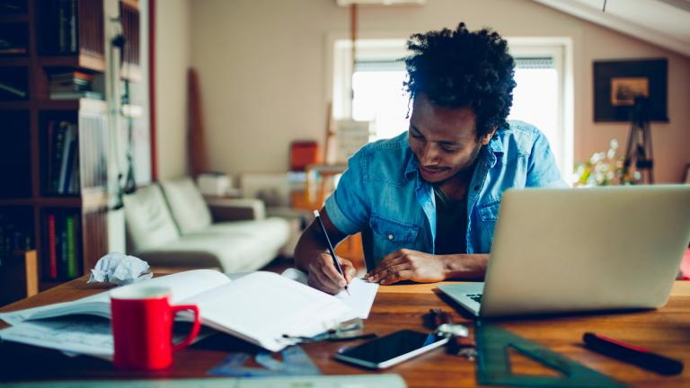 man studying and working from home
