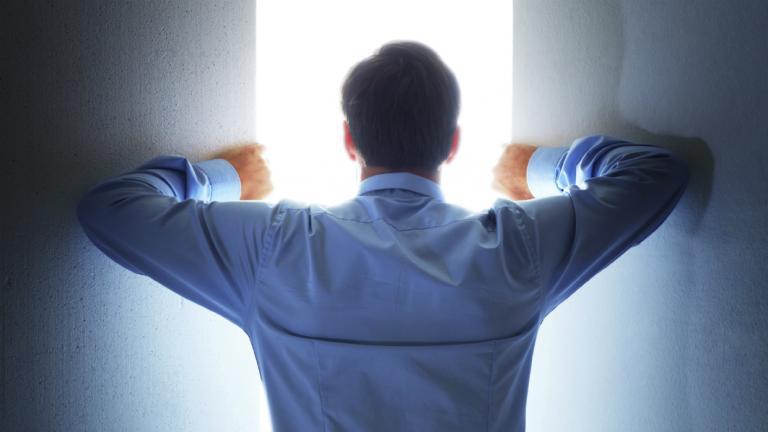 A man opening a door