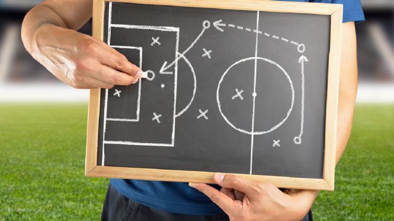 Football expert explaining tactics
