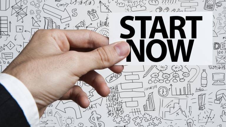 Man holding words 'start now'
