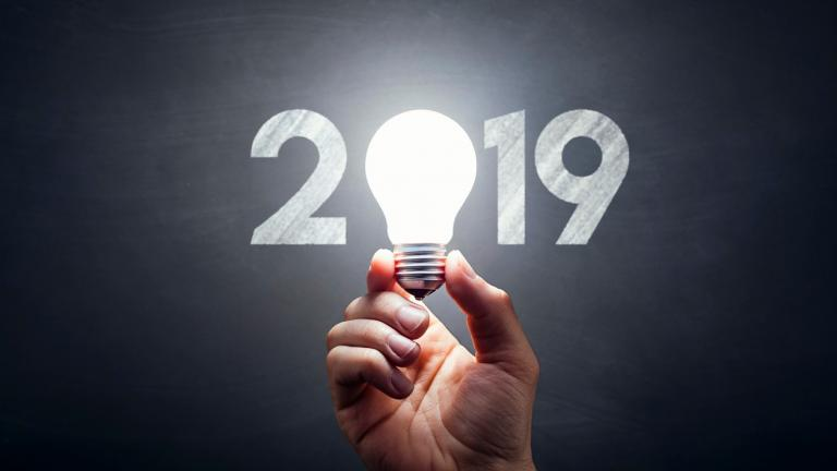 New Year 2019 - Light Bulb Hand Idea Blackboard