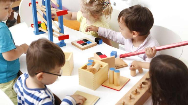 Children playing with wooden games