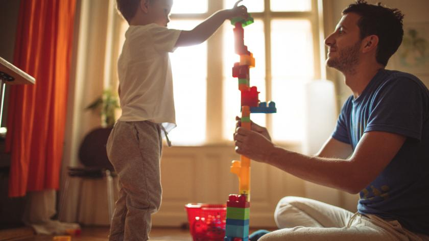 Father and son building a tower