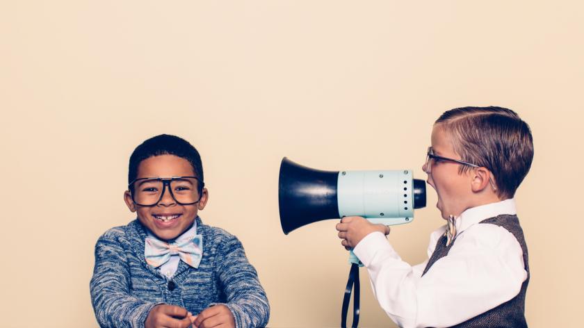 Child shouting through megaphone