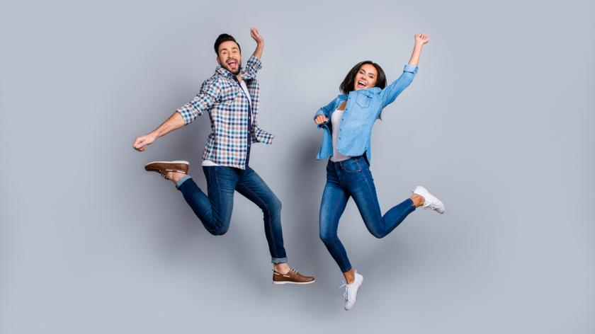 man and woman jumping in air