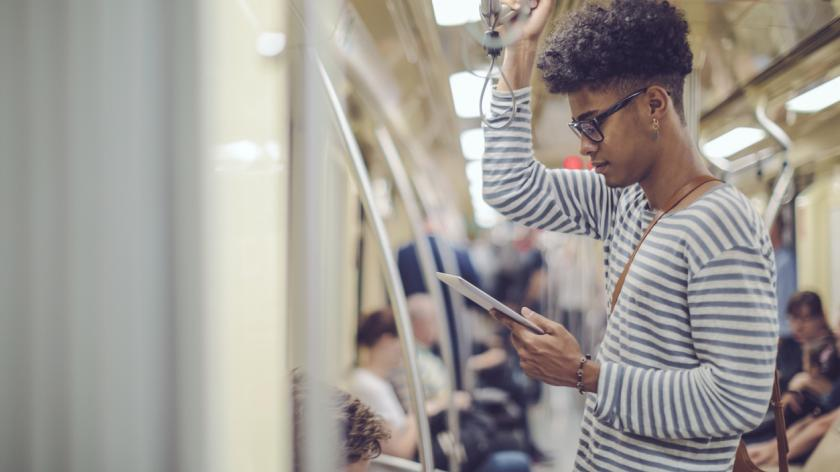 Employee reading business book on commute to work