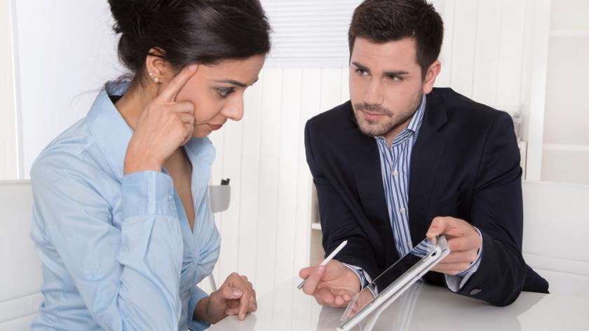 women receiving negative feedback in a meeting