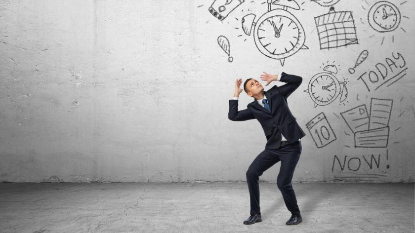 Businessman overwhelmed by work