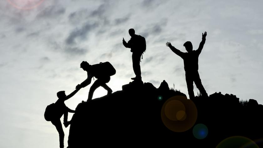 Climbers working together as a team