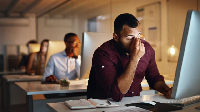 stressed man at his desk at work