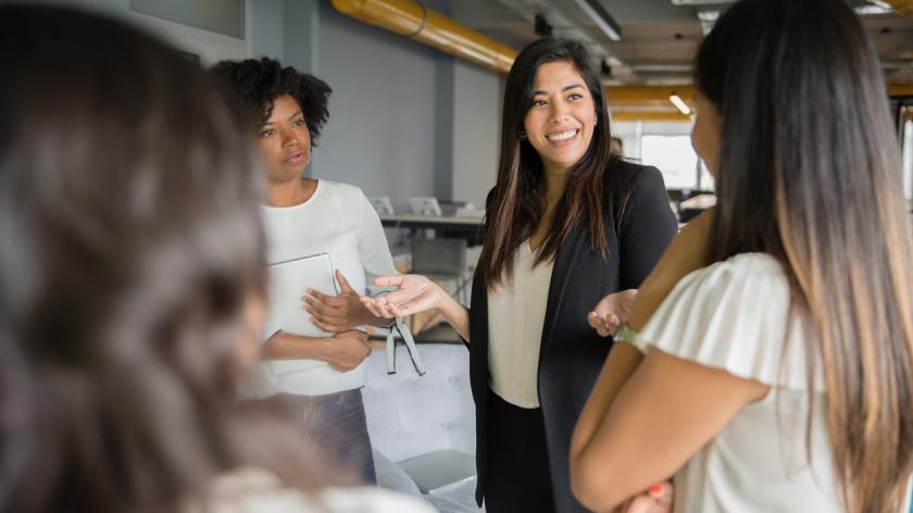 Businesswomen having informal conversation meeting in office