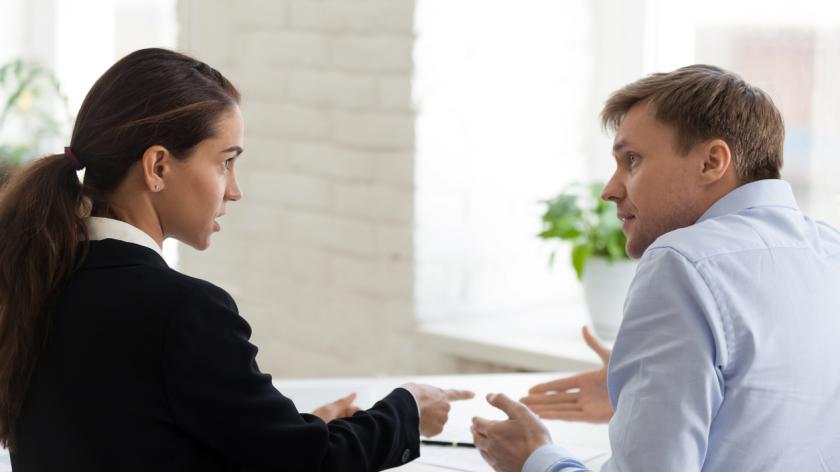 Conflict of female boss and male office worker