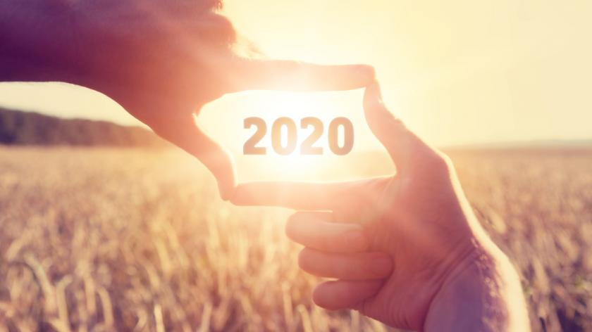 concept image of number 2020 in a frame of hands