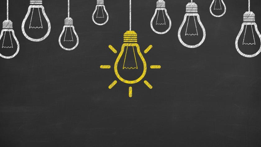 Idea concepts with light bulbs on a chalkboard background
