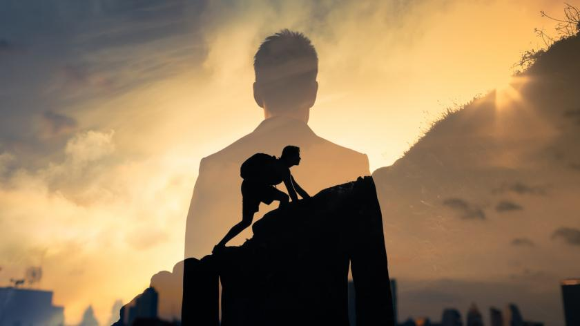 concept image of a business man overlaid with Man feeling determined climbing up a steep mountain side.