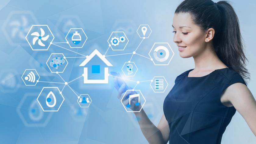 Smiling young woman in black dress looking at her smartphone with double exposure of smart home interface.