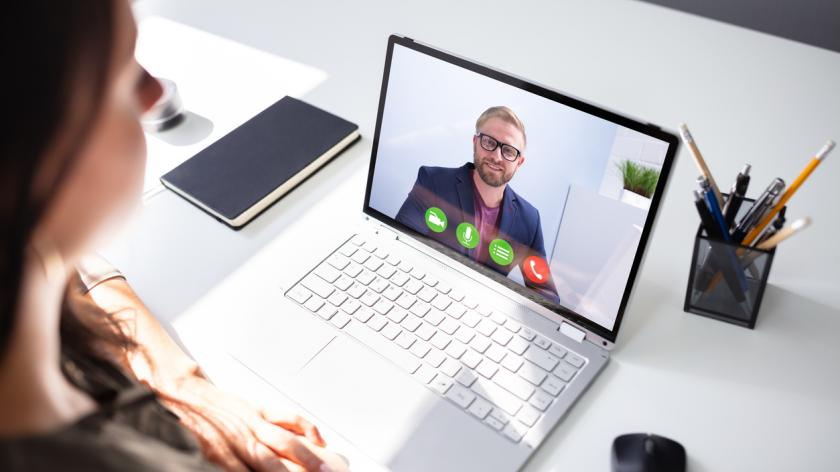 Close-up Of A Young Businesswoman Chatting With Her Colleague via video conference online
