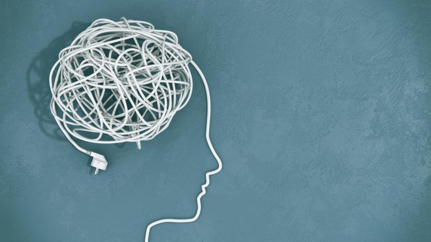 illustration of Tangled cables in a silhouette of the human head