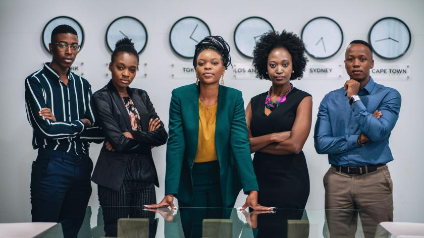 Portrait of young black business team standing in the office.