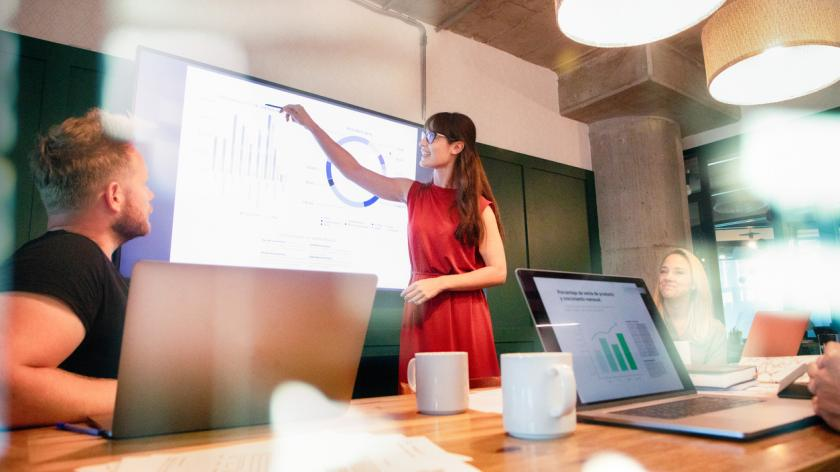 Business woman presenting with display screen