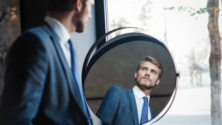 business man looking in a mirror