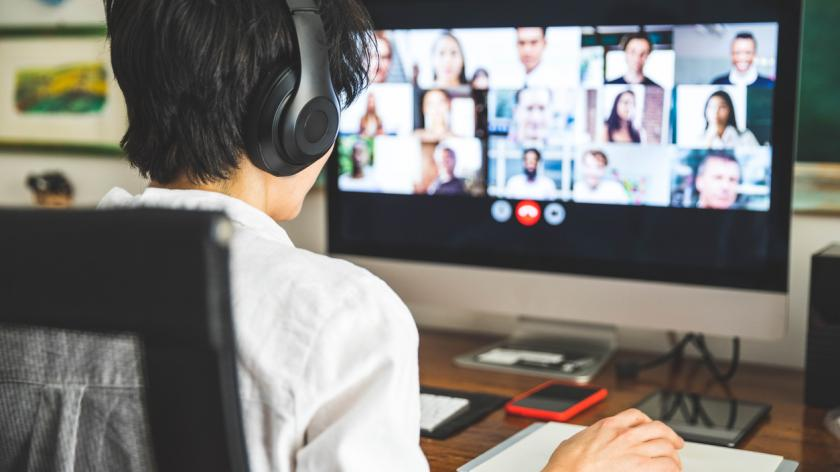 Woman working at home having a video conference with colleagues