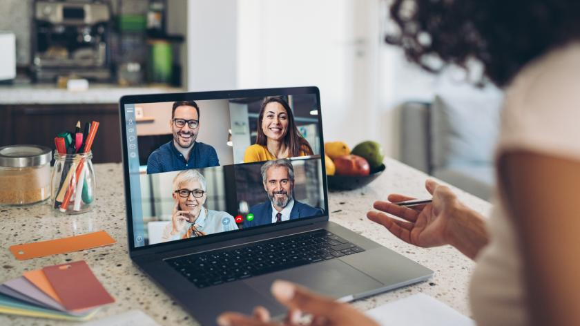 Group of business persons having a video conference