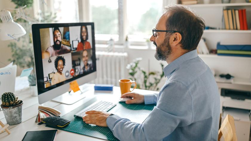 Businessman discussing work on video call with team members