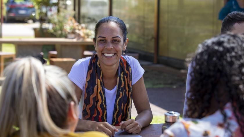 Close-up of young aboriginal students studying together outdoors in the sun in Australia.