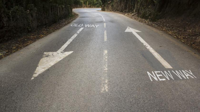 Road with the inscription Old way, New way with directional arrows. Concept for change, improvement and self-development