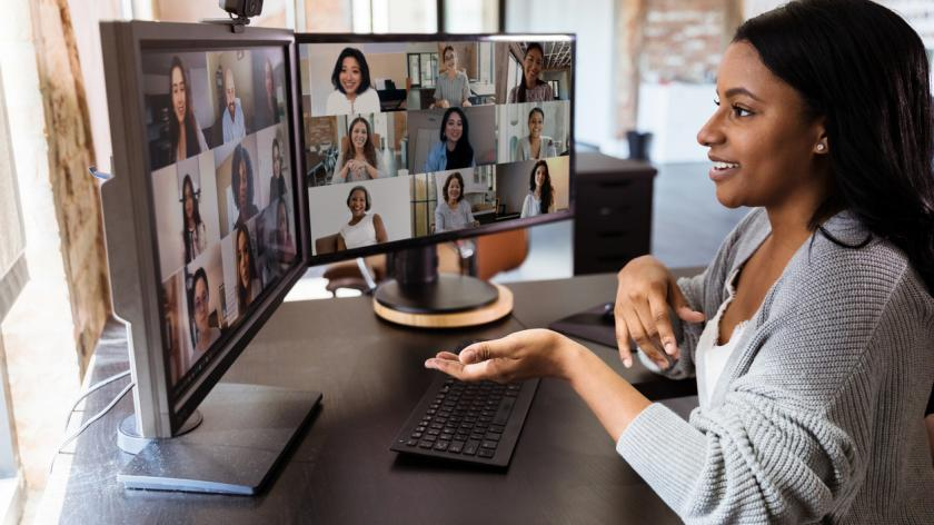 woman teleconferences to meet with her diverse colleagues. She is social distancing due to the coronavirus epidemic.