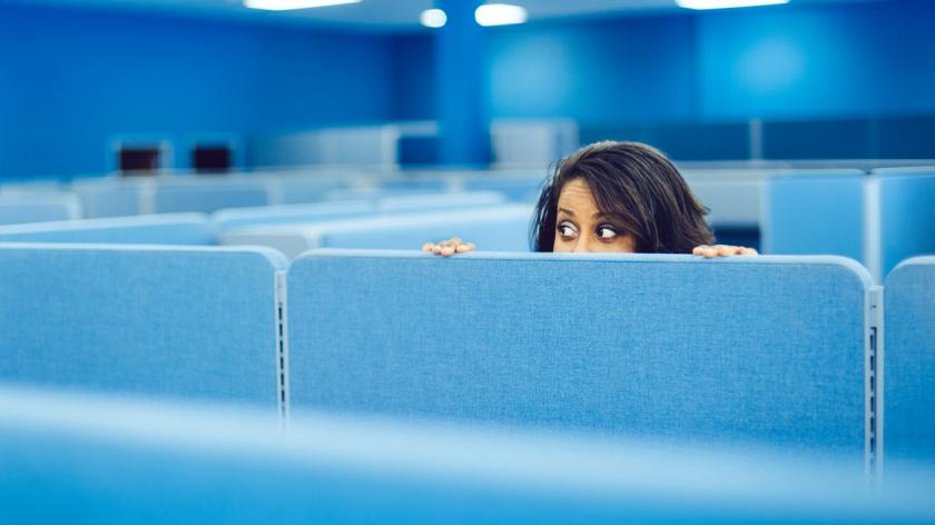 Office worker hiding in cubicle room