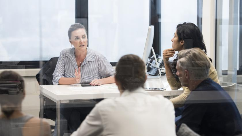 female leader in charge of meeting
