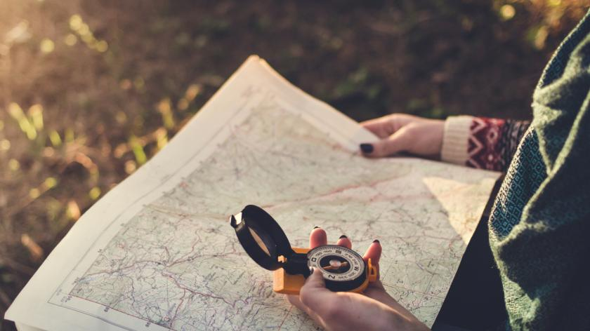 Trekker with map and compass