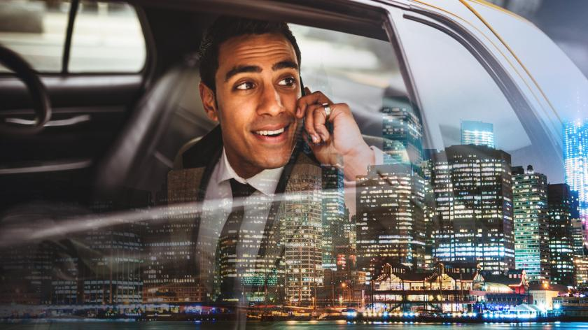 businessman making phone call in a taxi
