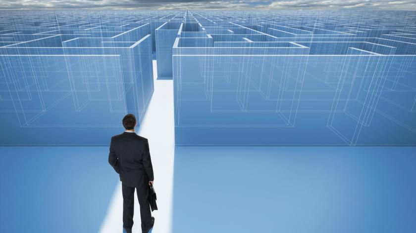 businessman finding a pathway through a maze