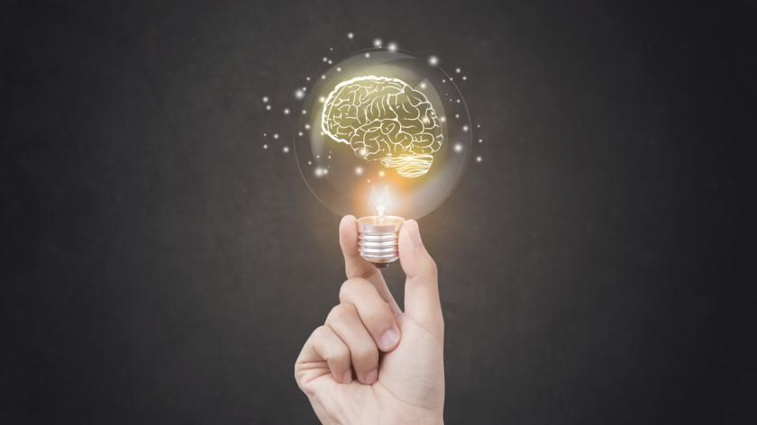 Lightbulb brainstorming creative idea abstract icon on business hand