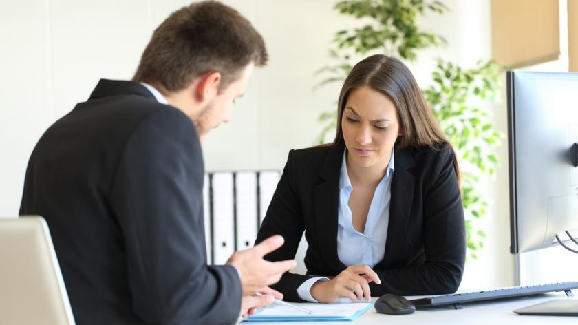 business man and woman having a difficult conversation